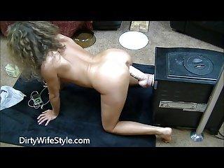 Hot brunette fucks huge dildo doggy style