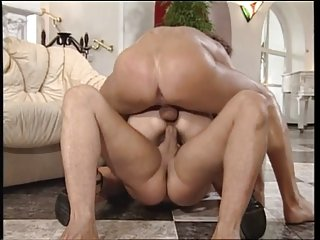 Gorgeous perky tit brunette gets double penetrated by two big dick men