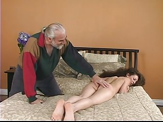 Lovely young brunette slave victim gets her ass turned red by caning
