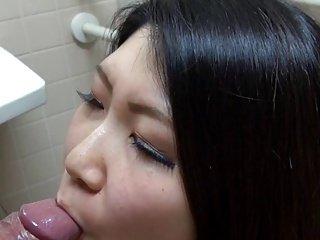 Yuna Sakurai sucks dick in public toilet