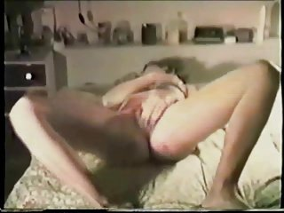 wife enjoyes herself on bed in front of hubby