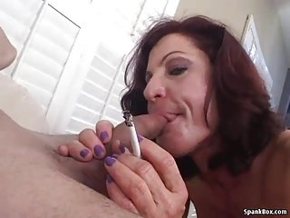 Smoking mom gives hot blow job