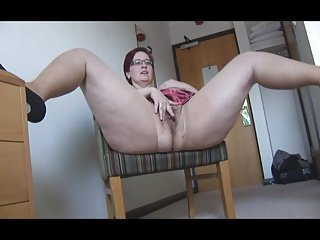 Busty mature BBW in pantyhose and mini skirt stripping
