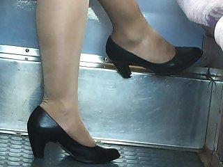 Beautiful feet in shoes high heels in train 19