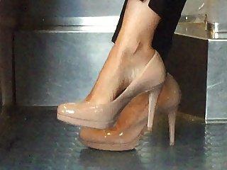Beautiful feet in shoes high heels in train 15