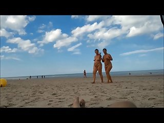 2 women in full-frontal nudity on the beach