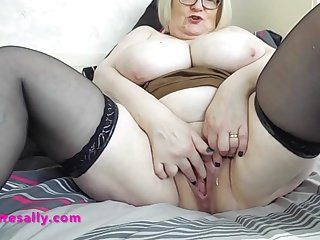 Granny plays with her freshly shave pussy