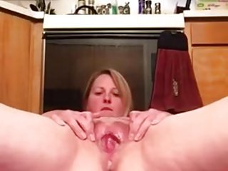 Hot lady pissing in the kitchen