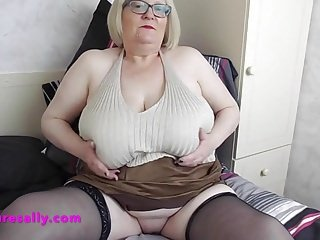 Randy Granny with big tits and shaved pussy